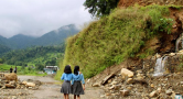 two girls and eroded  embankment
